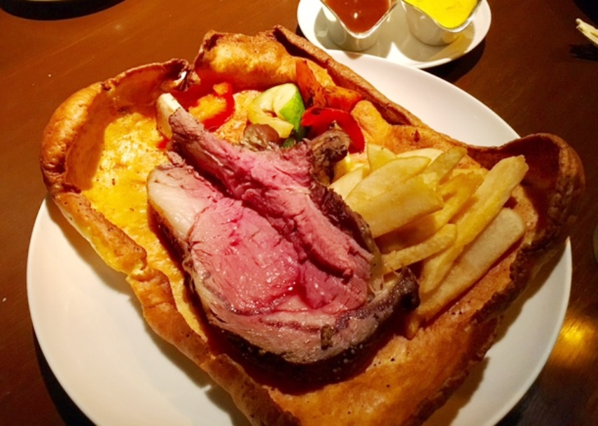 The irresistible Australian Black Angus Prime Rib served on a Yorkshire Pudding