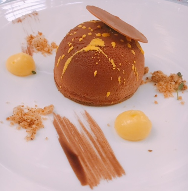 Valrhona chocolate cremeux, passionfruit sauce -- a light, lovely dessert after the sumptuous wines