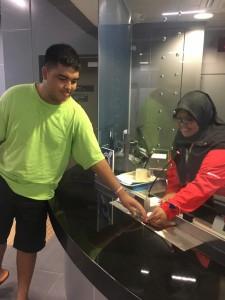 Fatin attending to Nicholas at the Bukit Dukong MRT station.