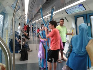 Nicholas (right) and Onn (centre) in the MRT