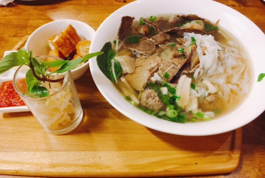 Pho Bo Dac Biet or Vietnamese Beef Noodles Special with raw beef, beef brisket, shank, tripe, tendon and beef balls