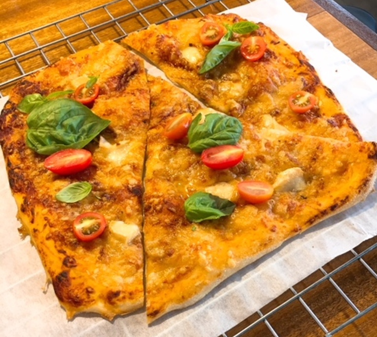Cheese pizza --mozarella, cheddar, brie, cherry tomatoes, basil