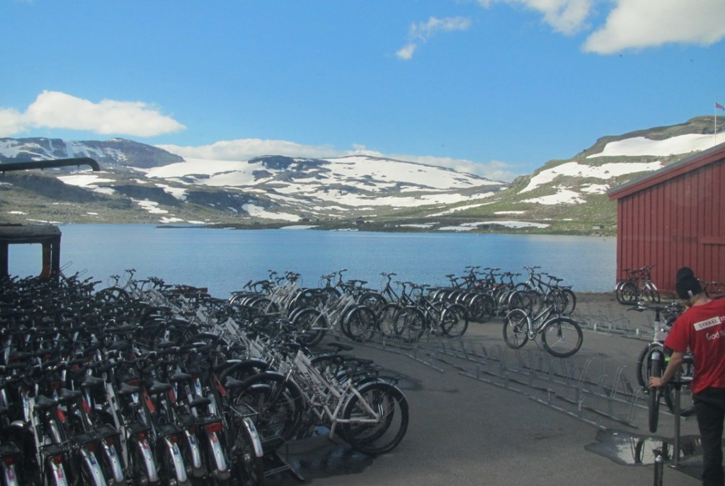 Norwegians love to cycle. Blue skies in the summer make it ideal for the outdoors though there is still snow on the mountains. A view from our coach