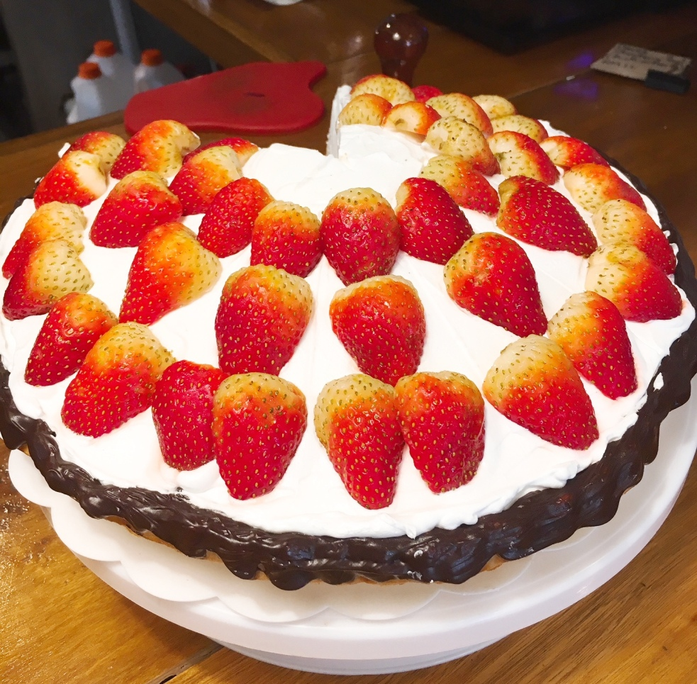 Strawberry Tart layered with home-made marzipan, Belgian chocolate and fresh vanilla cream, topped with strawberries