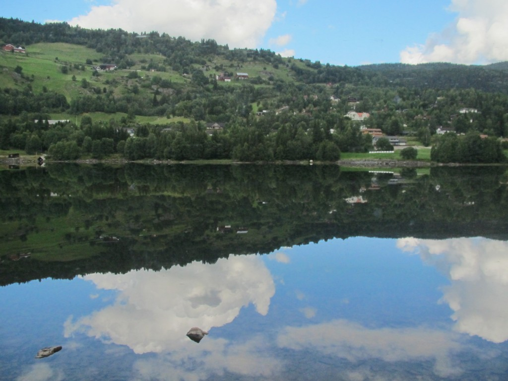 The clear blue sky reflected in the lake in late summer. Nature's beauty greets us on our train ride to Mrydal
