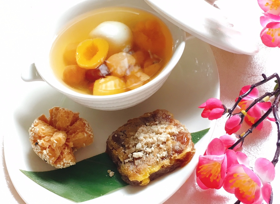 Sweet Ginger Soup with red dates, dried apricot and black sesame dumplings; Panfried Ninko with walnut and crispy sesame ball
