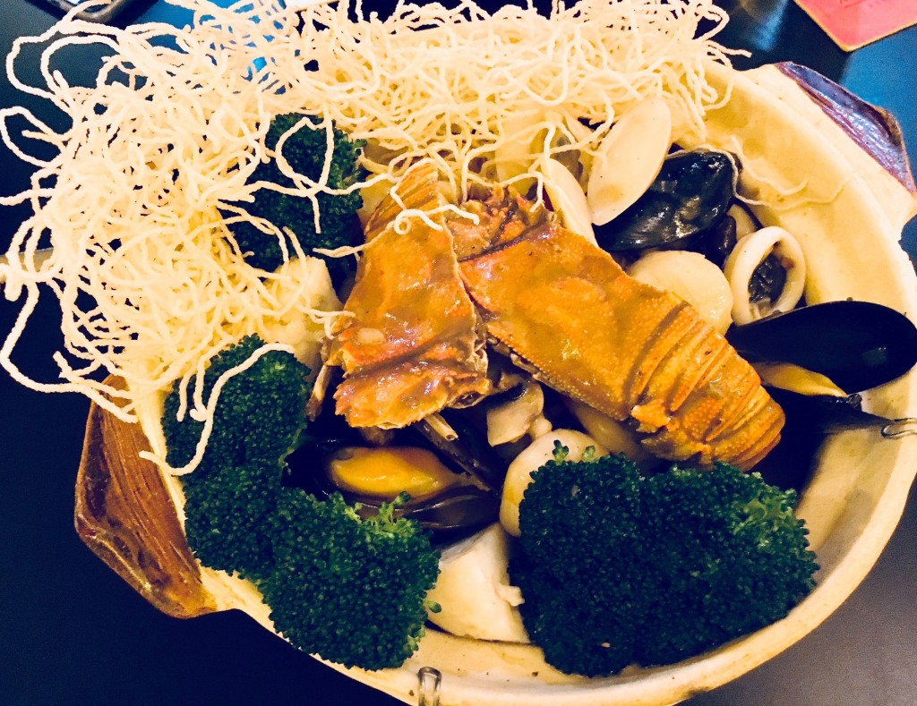 Sea Treasures of abalone, mussels, clams, prawns, scallops, squid, baby lobster, mushrooms and vegetables