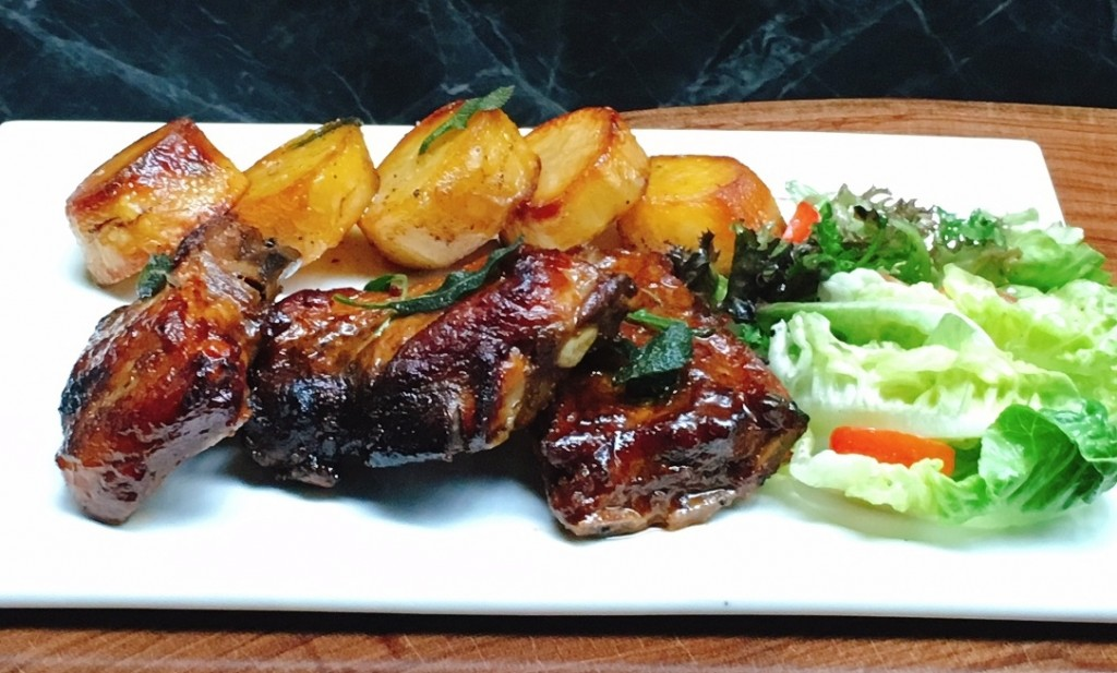 Costolette di Maiale -- Grilled pork ribs with barbecue sauce, served with roasted potatoes and salad