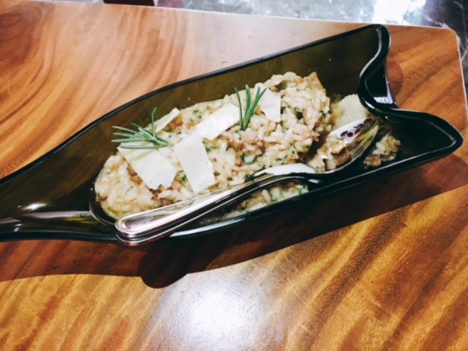 Risotto Con Salsiccia E Vino Rosso or risotto in a red wine reduction with Italian sausage