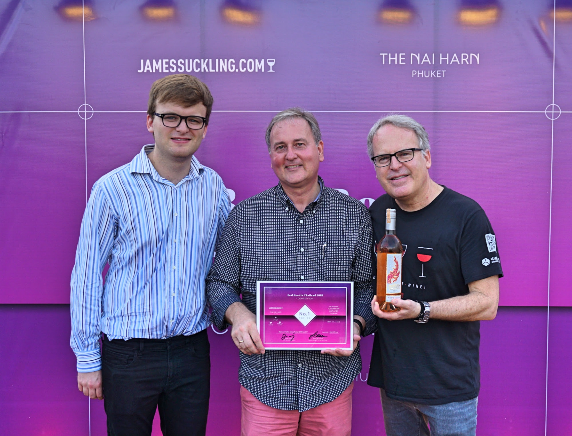 Jack Suckling (left), Frank Grassmann (centre) General Manager of THE NAI HARN Phuket and James Suckling (right) at the BEST ROSÉ in THAILAND awards ceremony