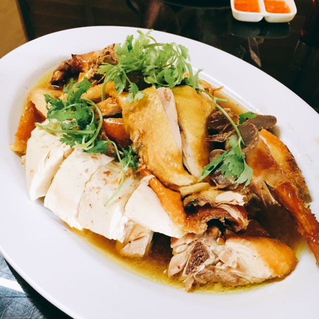 The tasty Roast Chicken served with a garlicky ginger chilli sauce to be eaten with  chicken rice