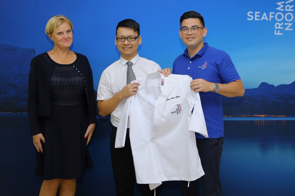 Presentation of chef's jacket to Chef Chua