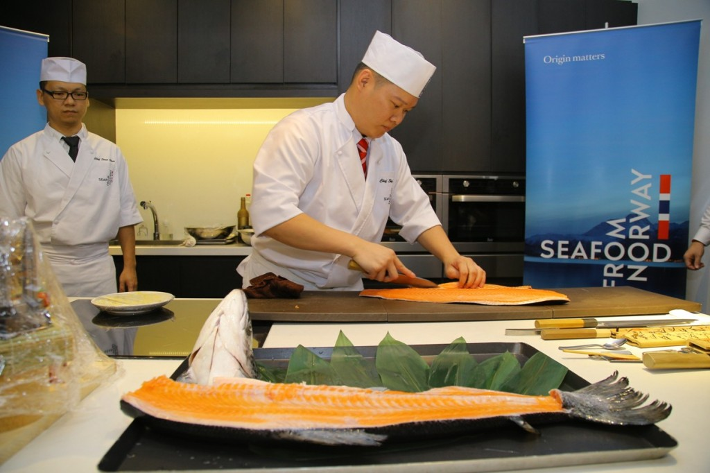 Chef Sky showing his knife skills with Norwegian salmon